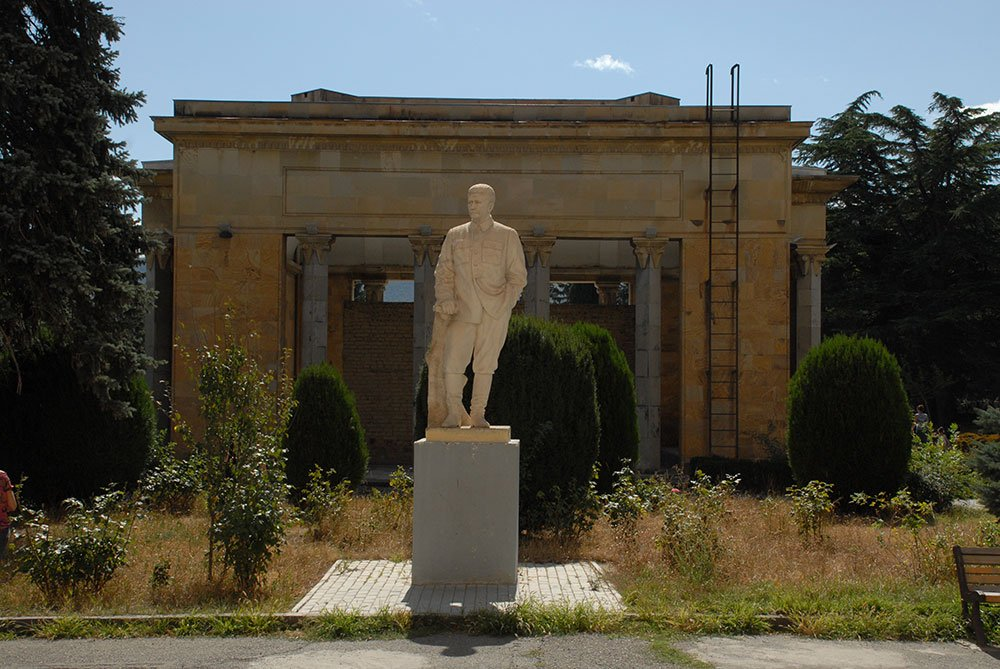 A statue of Stalin stands behind the house he was born in. Image: Guram Tsibakhashvili