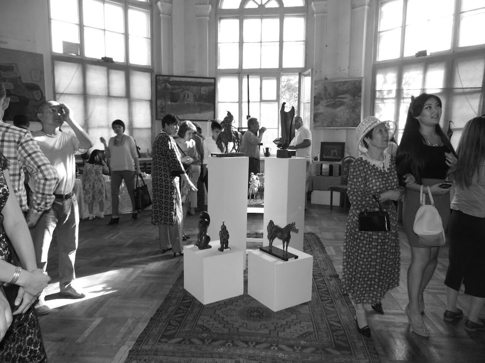 Guests at an exhibition opening in Gallery M in Bishkek