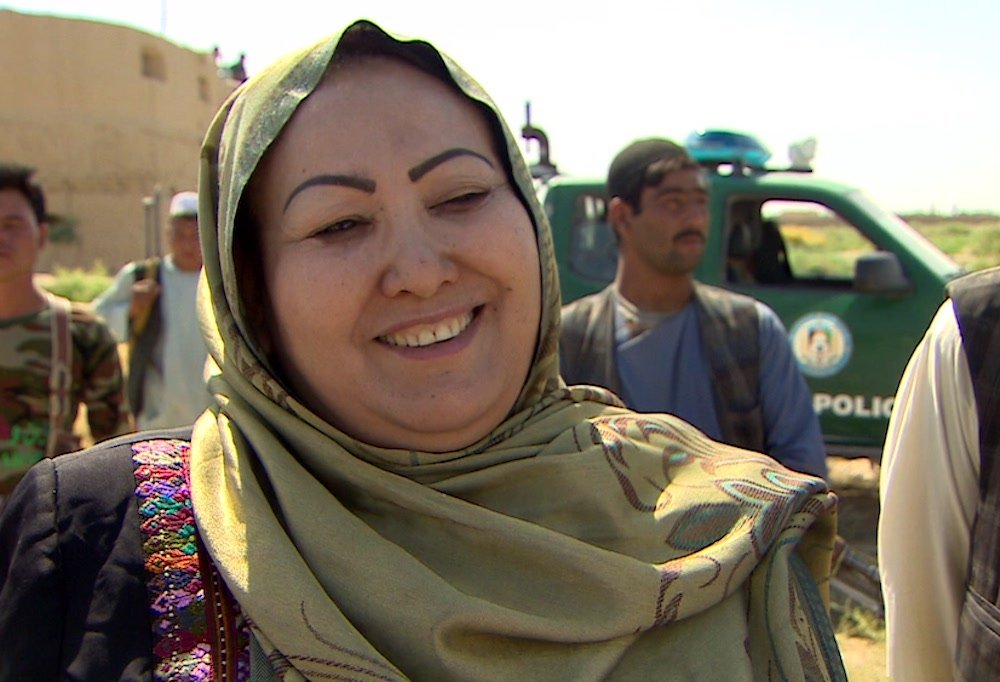 Screenshot of a news report featuring Soyra Saddot, Afghanistan's first female district governor