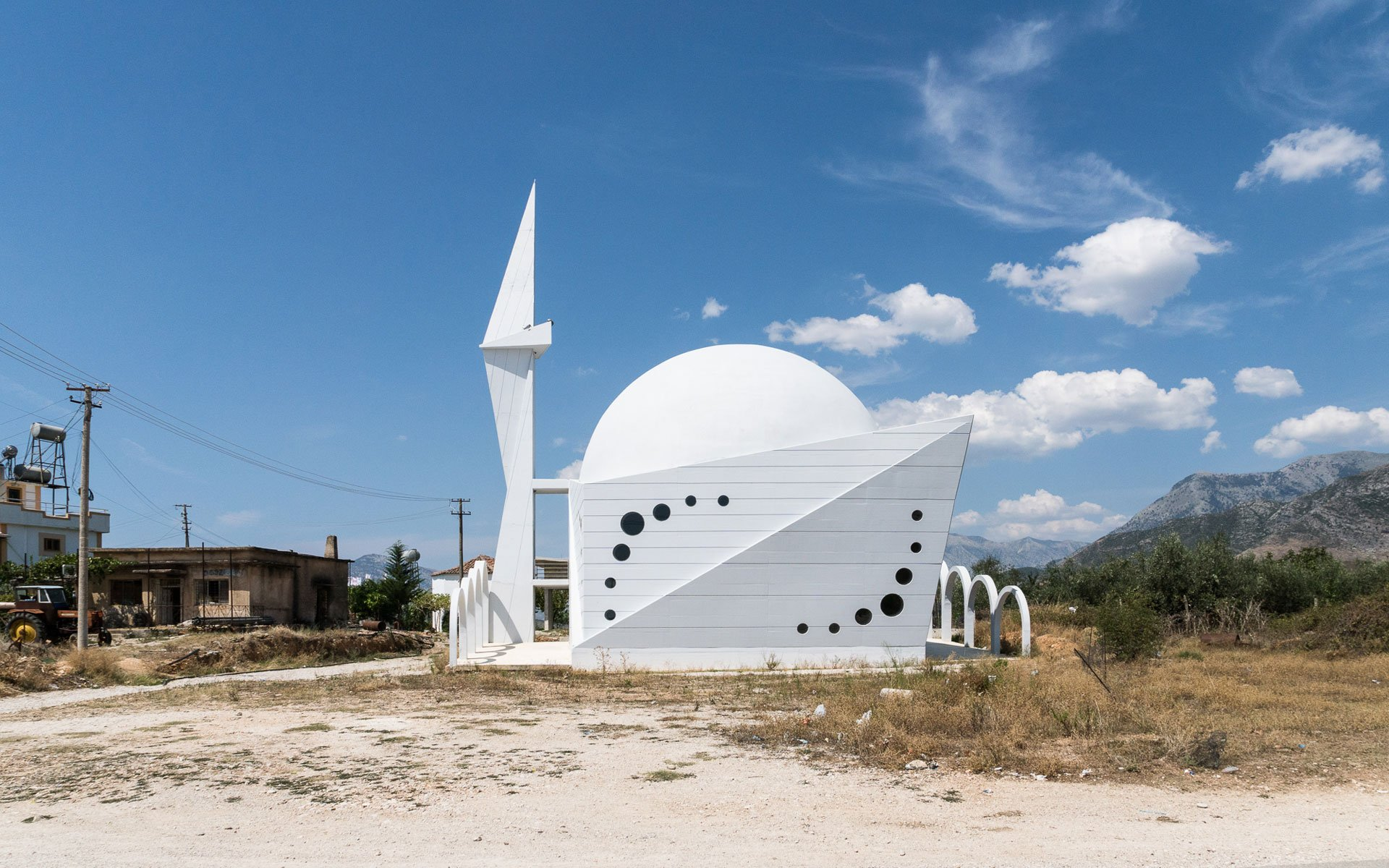 Take a moment to reflect on the pristine, geometric beauty of this roadside Albanian mosque
