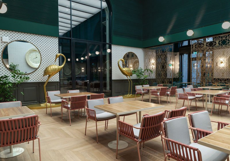 This cosy coral and sage-hued restaurant in Warsaw is already scooping up major design world prestige