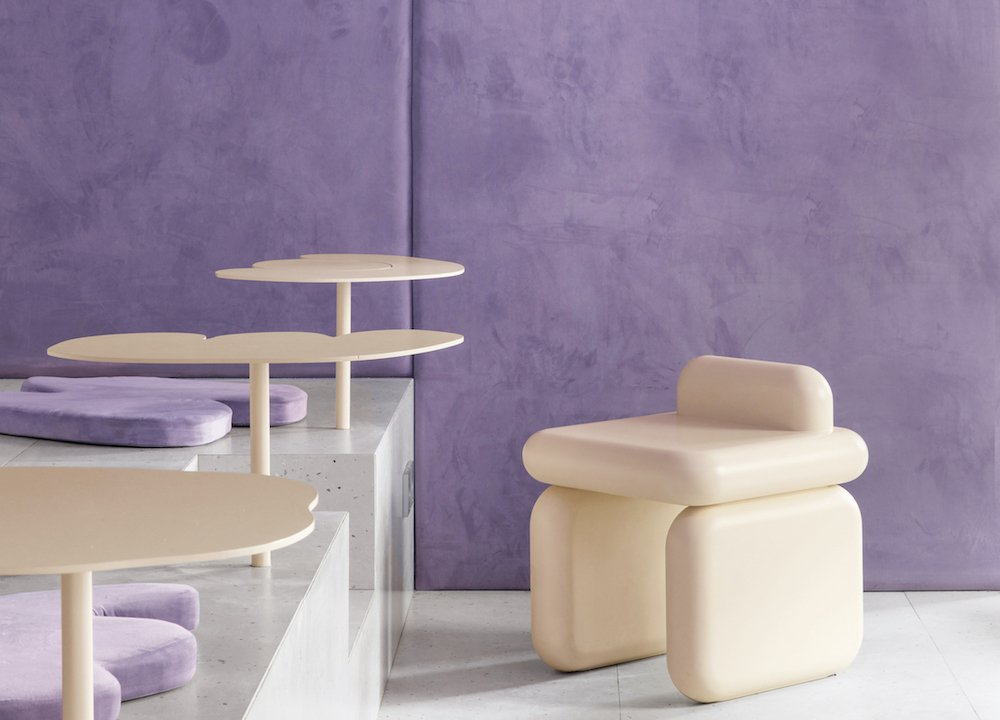 A purple and cream doughnut-inspired cafe in Voronezh is a sweet-tooth paradise