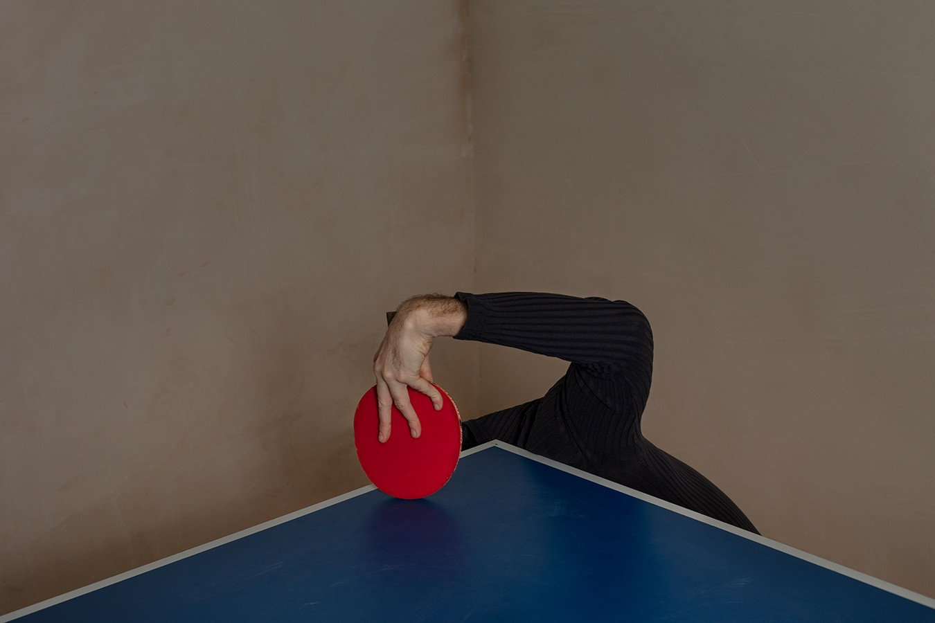 """Prozac: Self-Portrait with a Tennis Racket. """"Staying with his parents and lacking income as well as energy, he felt like a burden. Here he's cowering under the table tennis table, hardly even visible as a human."""""""