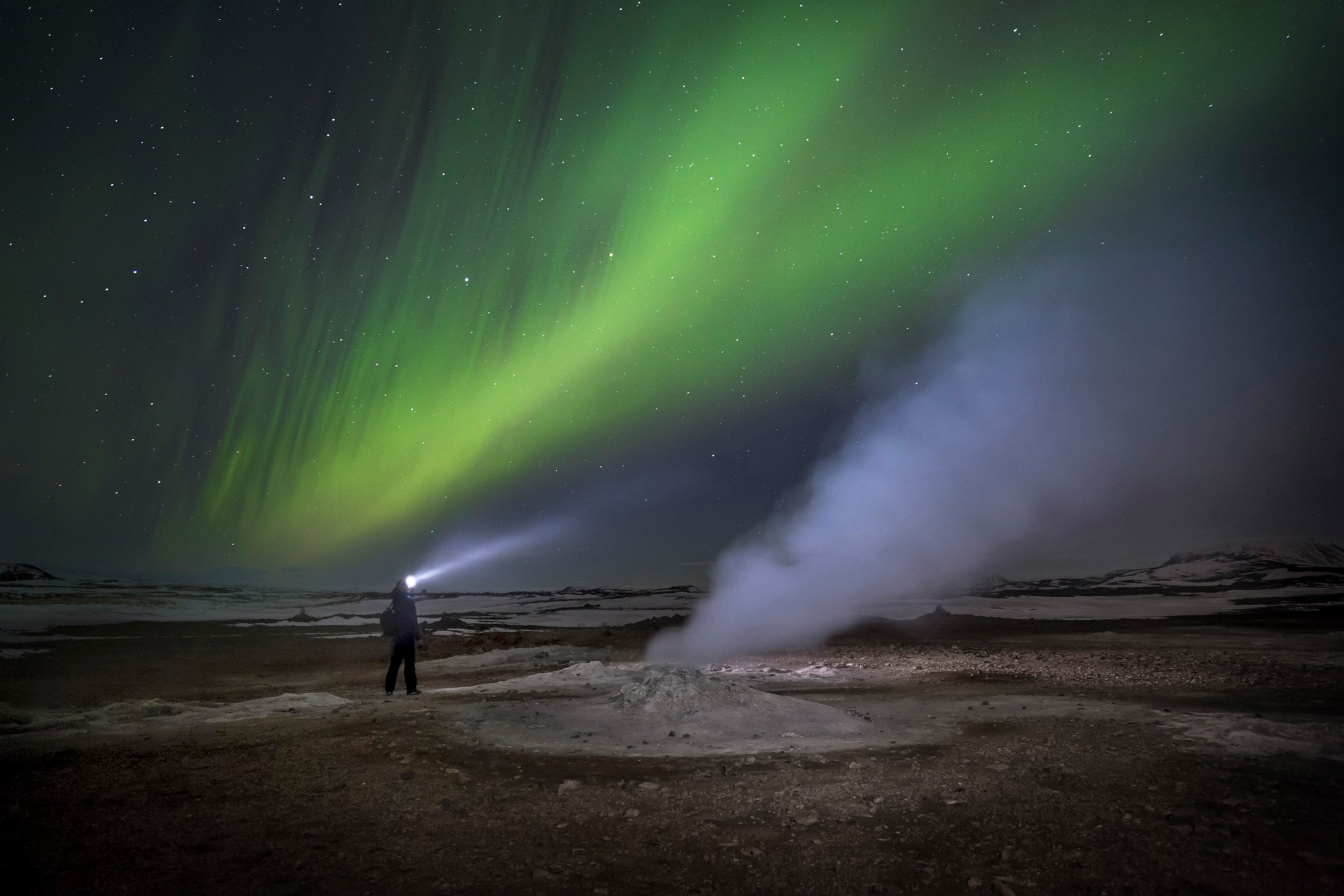 """""""Northern Lights at the reindeer herders' camp. Accustomed to them, one local person looked at my shot with curiosity, probably trying to understand why it interested me"""" Image: Vladimir Alekseev/www.tpoty.com"""