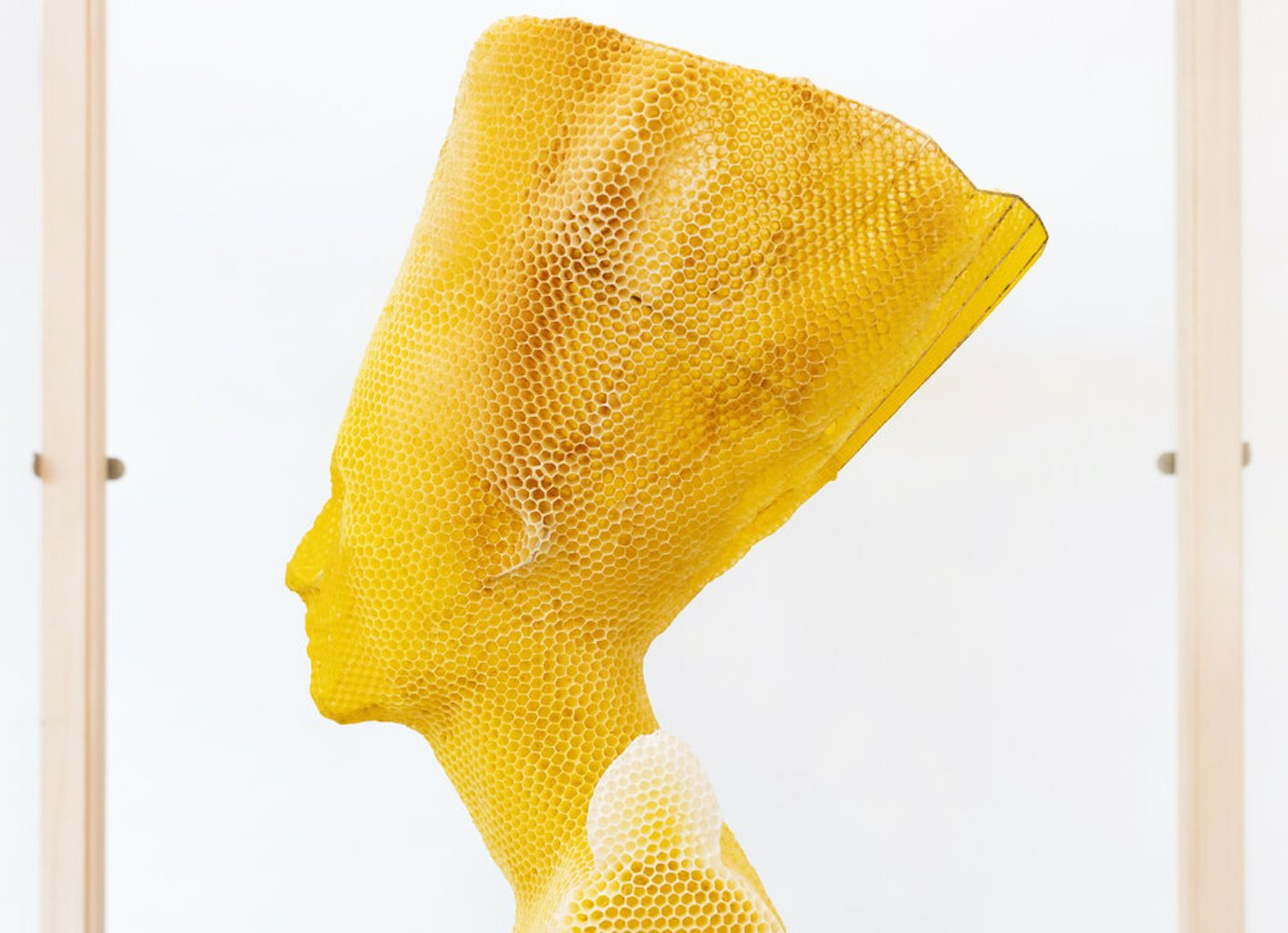 Made by bees: Slovak artist uses honeybees to sculpt a wax bust of Nefertiti