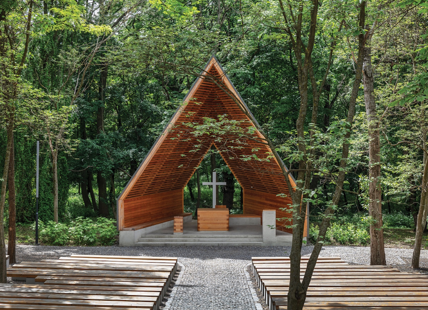 Hungarian architecture studio design modern open-air church made from a former Soviet monument plinth