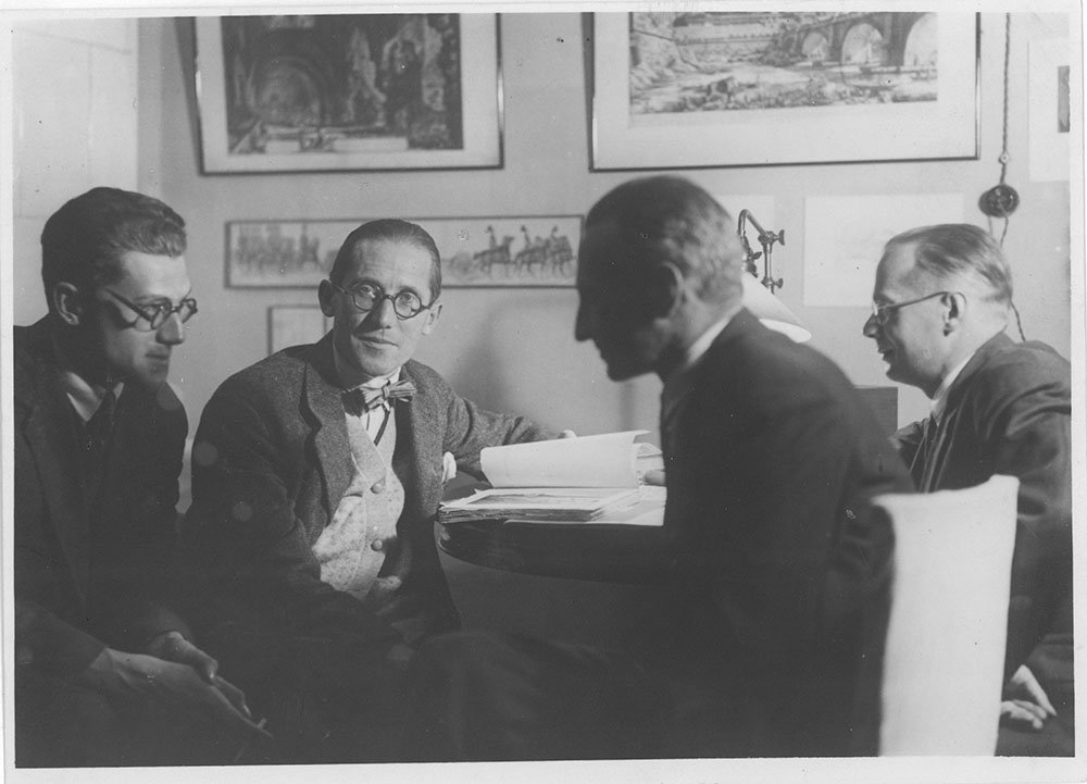 Le Corbusier (2nd from left) sitting with Soviet modernist Andrei Burov (far left) in 1928