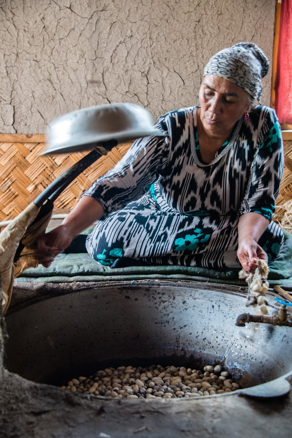 Woman boiling silk cocoons. Image: 2008+ under a CC licence