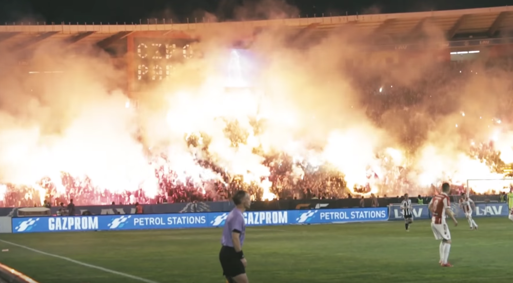 Fans let off flares and fireworks at a Red Star — Partizan derby in 2015. Image: COPA90/Youtube