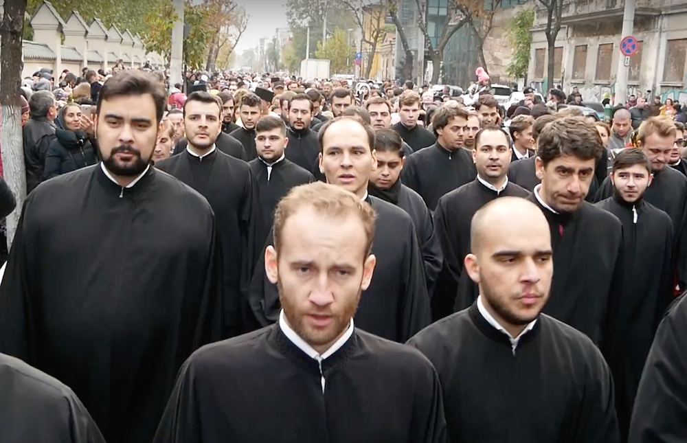 Romanian Orthodox priests walk the streets during Kirill's visit to Bucharest. Image: Casa Jurnalistului/Youtube