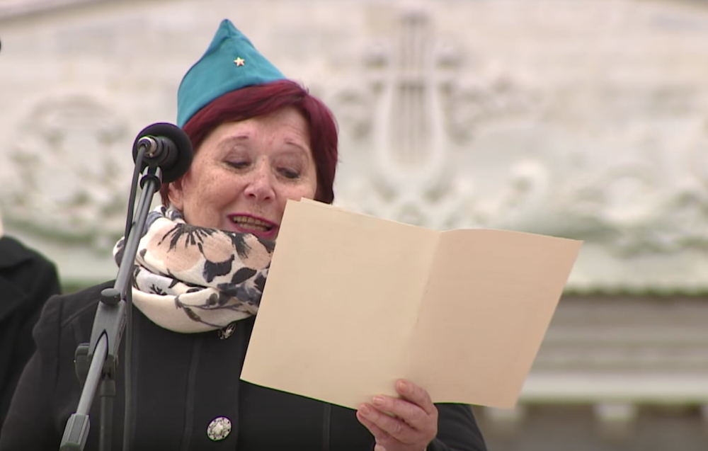 A former Komsomol member reads the letter retrieved from the Tiraspol capsule in a public ceremony. Image: TCB/Youtube