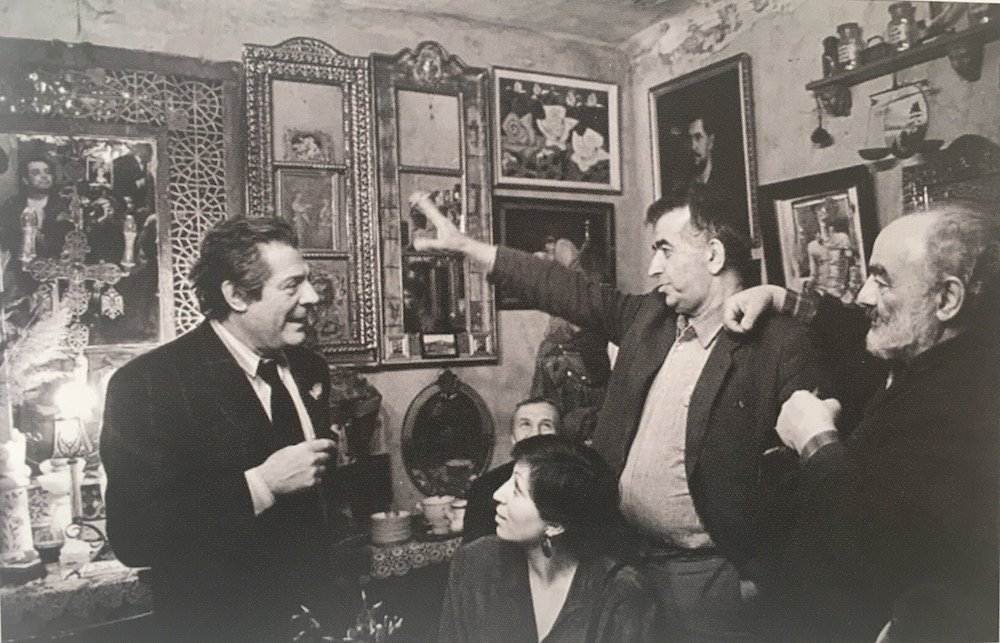 Jorbenadze (centre) and Parajanov (right) entertain Italian actor Marcello Mastroianni in Jorbenadze's elegant Old Tbilisi home. Image courtesy of Irakli Kovzanadze