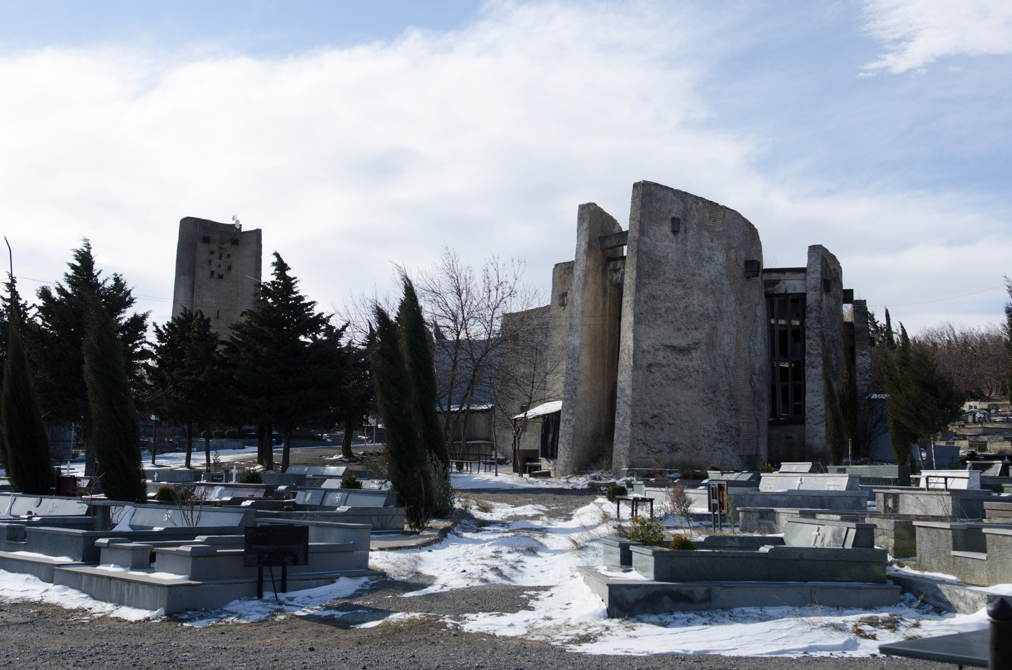 The cemetery office at Mukhatgverdi. Medieval Georgian gravestones adorn the facade. Image: Vladimer Shioshvili