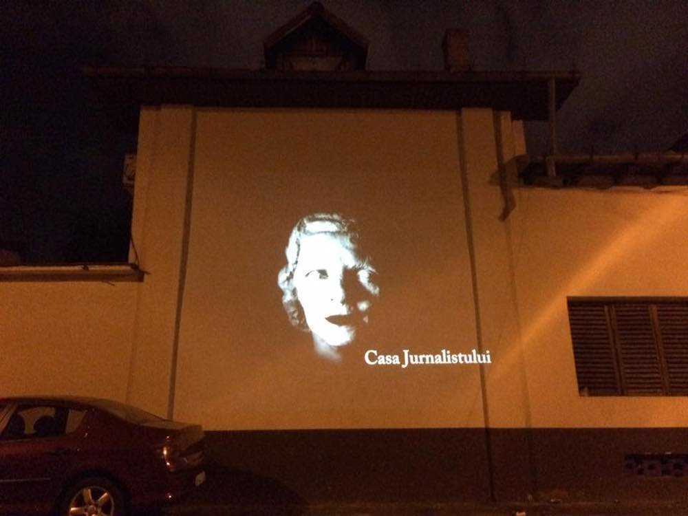 Projection of the Casa Jurnulistului logo during an open-air screening in Bucharest. Image: Casa Jurnulistului/Facebook