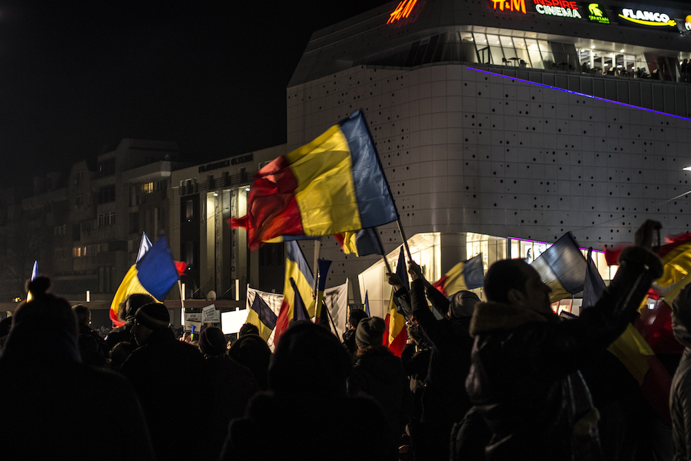 Romanian flags at a protest in Craiova. Image: Albert Dorin under a CC licence