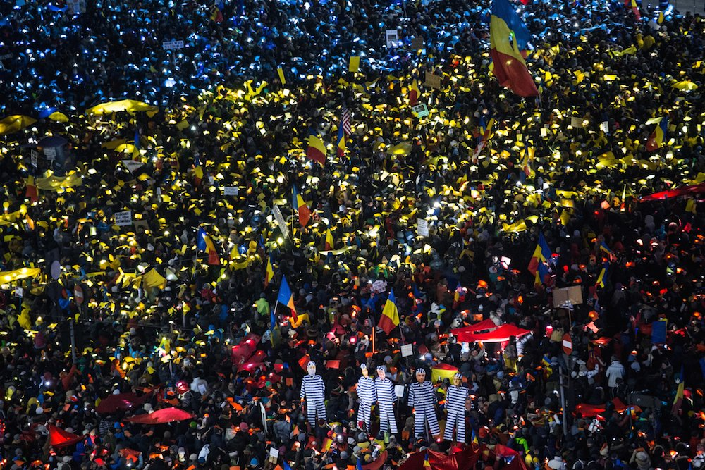 Protesters in Bucharest create an image of the Romanian flag during anti-corruption demonstrations in January. Image: Ioana Moldovan