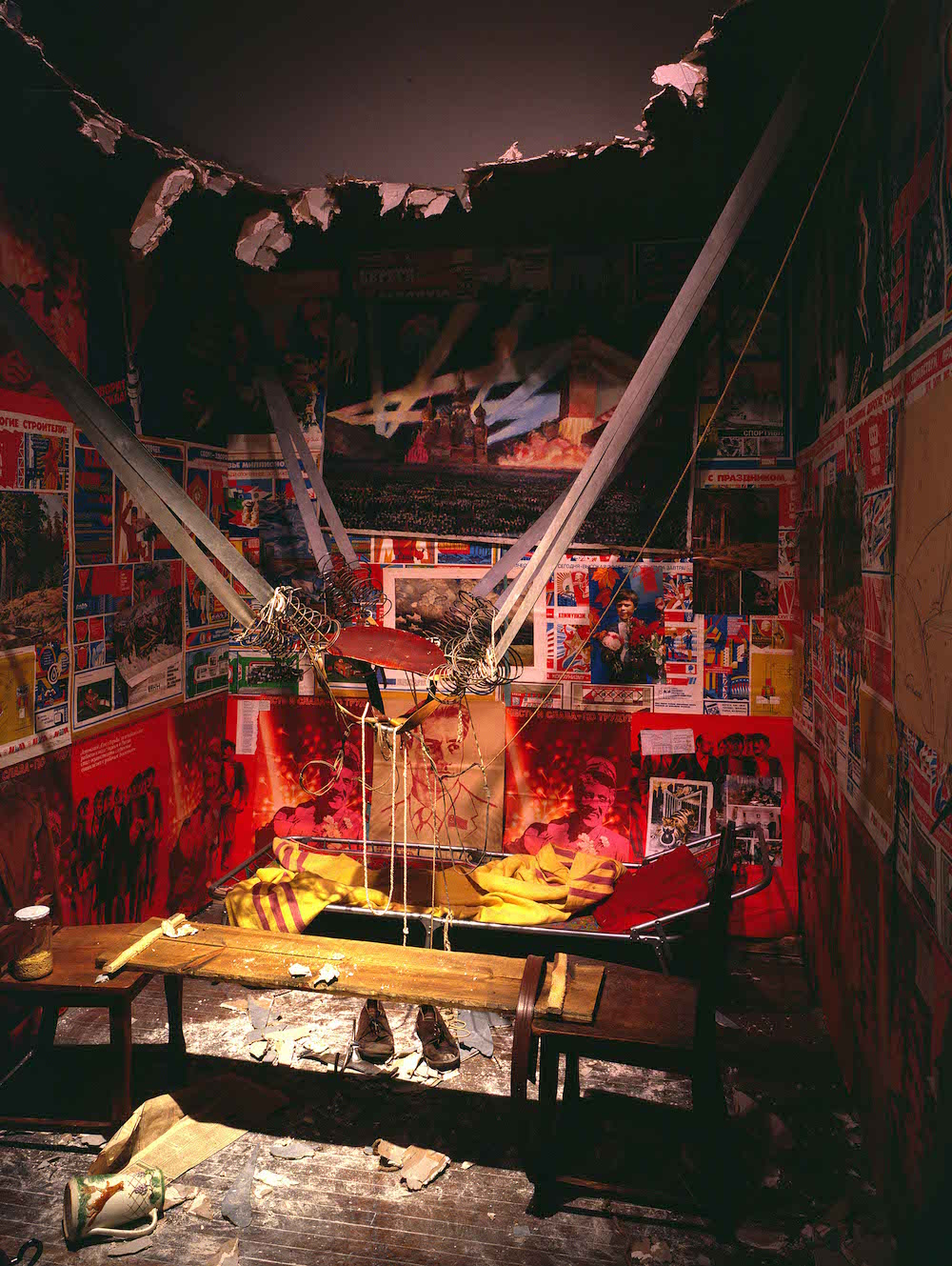 <em>The Man Who Flew Into Space From His Apartment</em> (1985) by Ilya Kabakov, on display at Tate Modern