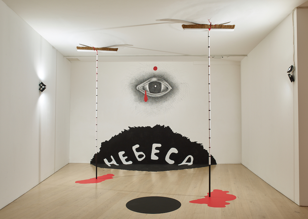Installation based on a sketch from Dmitri Prigov's <em>Series with Brooms</em> (2000s), on display at Calvert 22 Space. Image: Stephen White