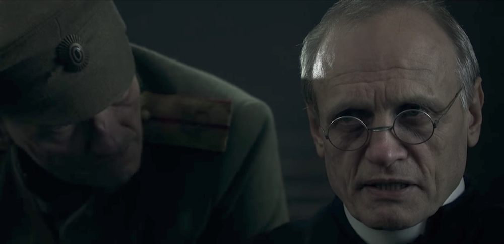 Witold Bieliński as Father Władysław Mendrala in <em>Broken Ear</em>. Image: Youtube