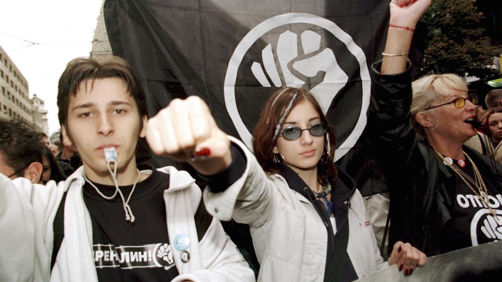Protesters from the Otpor! movement march on Belgrade in October 2000 demanding the removal of Slobodan Milošević.