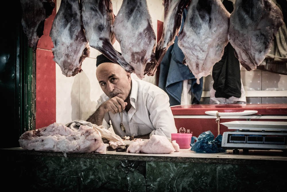 A butcher in Dushanbe's central market. Image: Ronan Shenhav under a CC licence