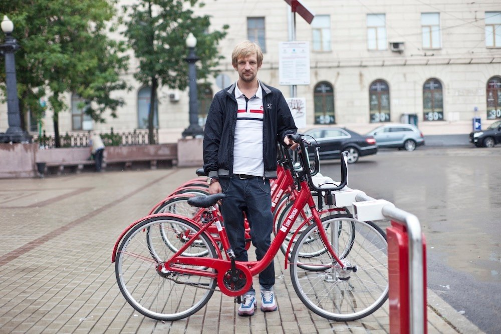 Vadim Hazov standing next to a bike rental station in Moscow