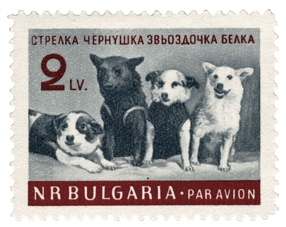 Stamp showing a group portrait taken at the press conference held on 28 March 1961