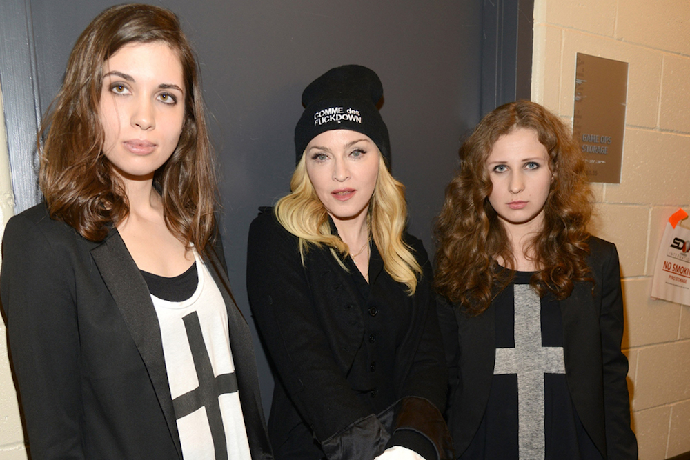 Nadya Tolokonnikoa (L) and Maria Alyokhina (R) with Madonna