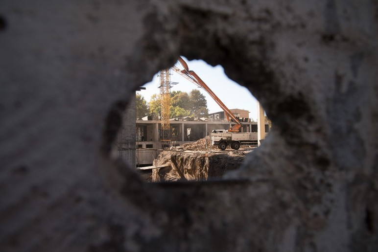 View onto a construction site from within the courtyard of a Stalinist apartment block
