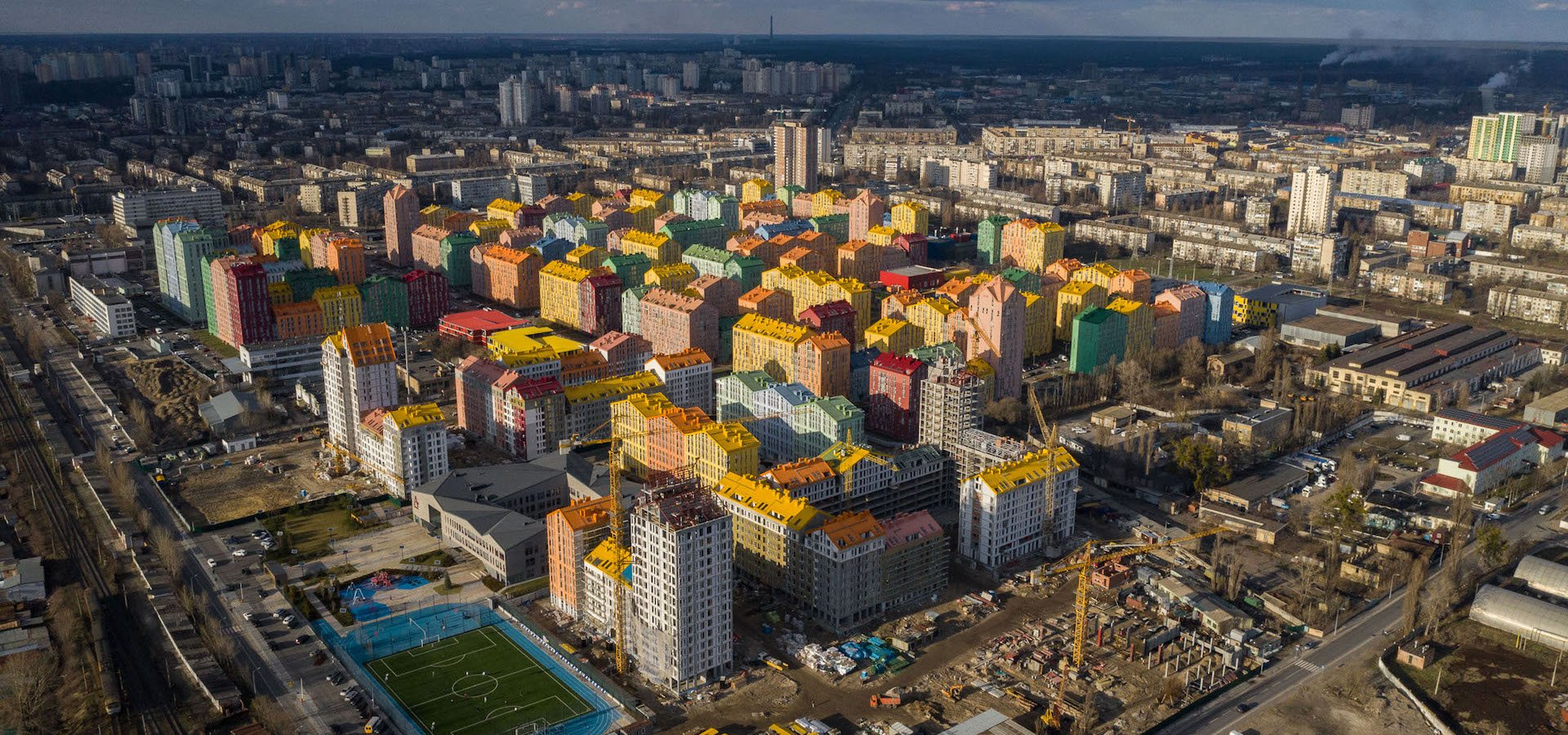 A nation's tensions are laid bare in Kyiv's colourful city-within-a-city. Welcome to Comfort Town