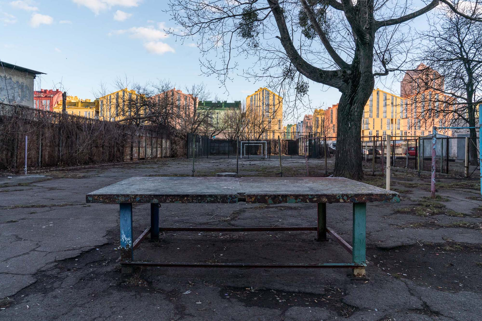 A decaying table tennis table in the yard of a neighbouring khrushchevka. Common areas of the older Soviet-era estates are generally poorly maintained