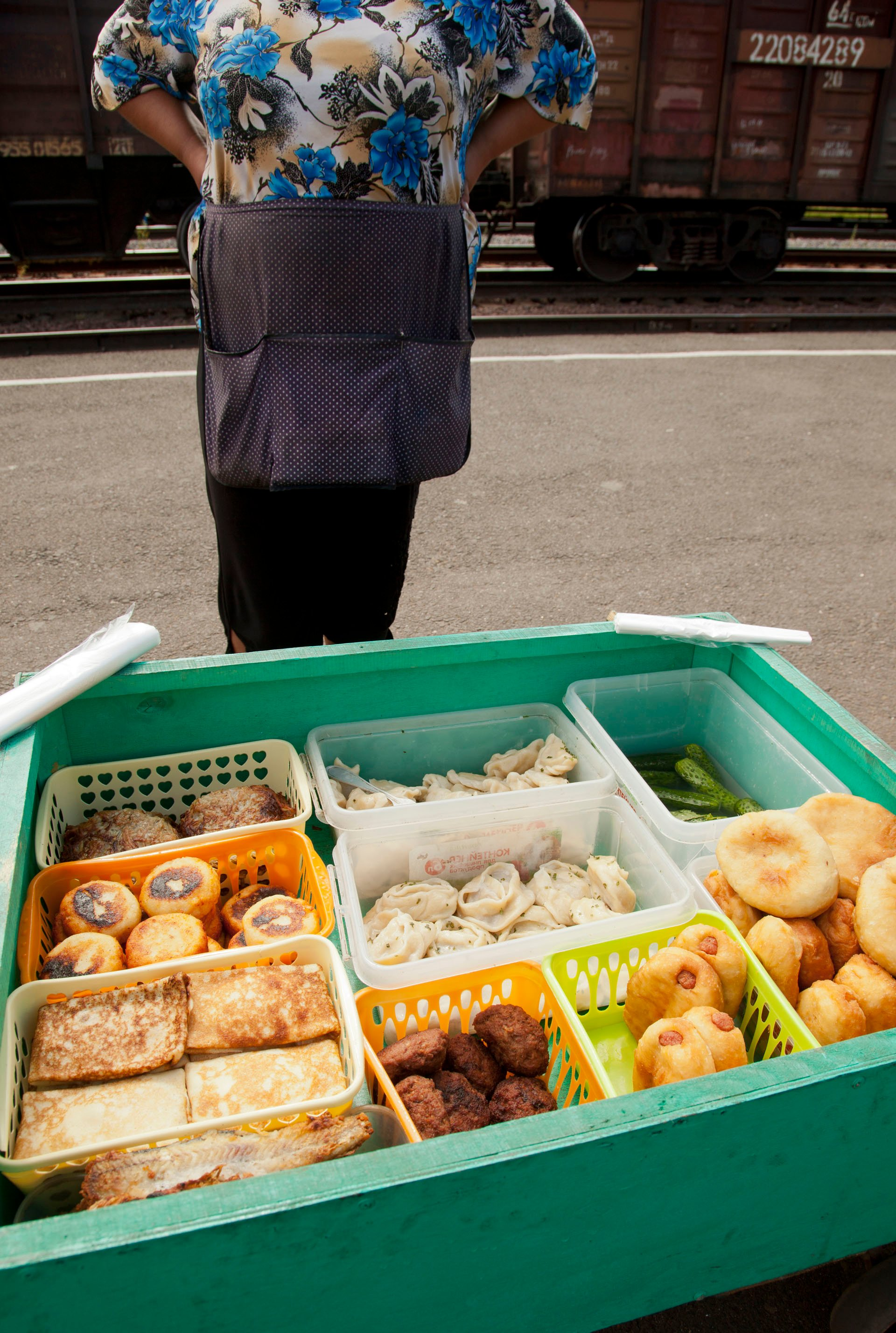 Families make full incomes and grandmothers supplement their pensions by selling hot homemade goods to travellers on the Trans-Siberian railway no matter the time of day
