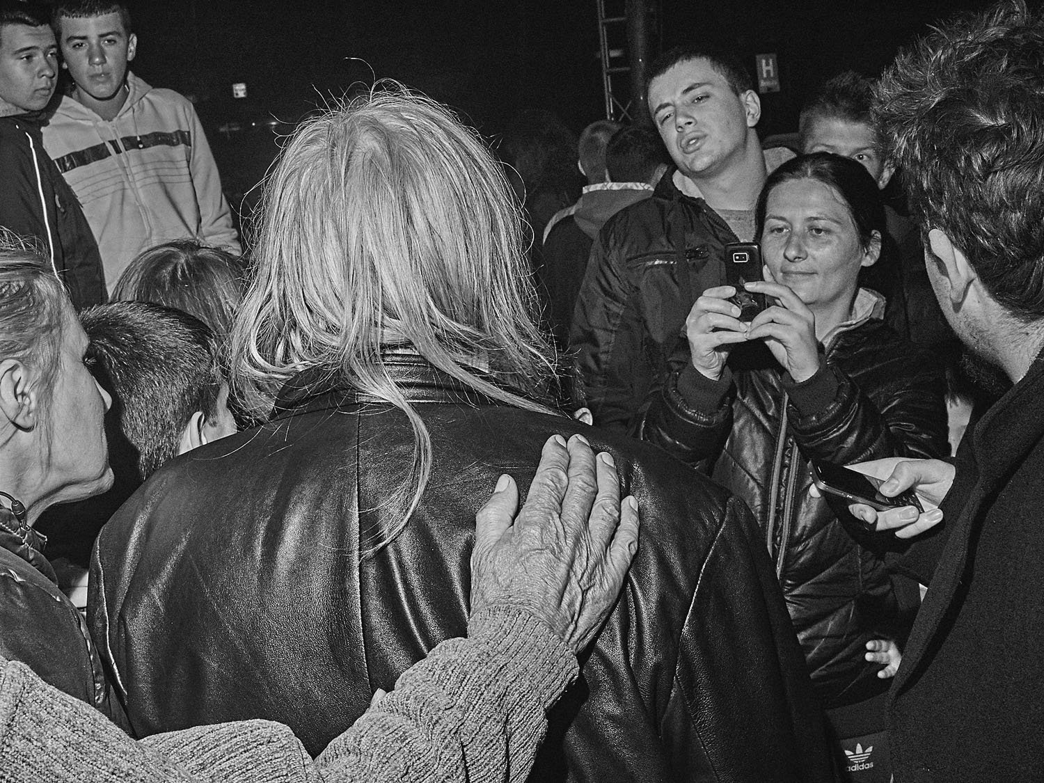 People welcome Bora Djordjevic, the frontman of nationalist band Riblja Cobra, in Mitrovica the night before elections in Kosovo