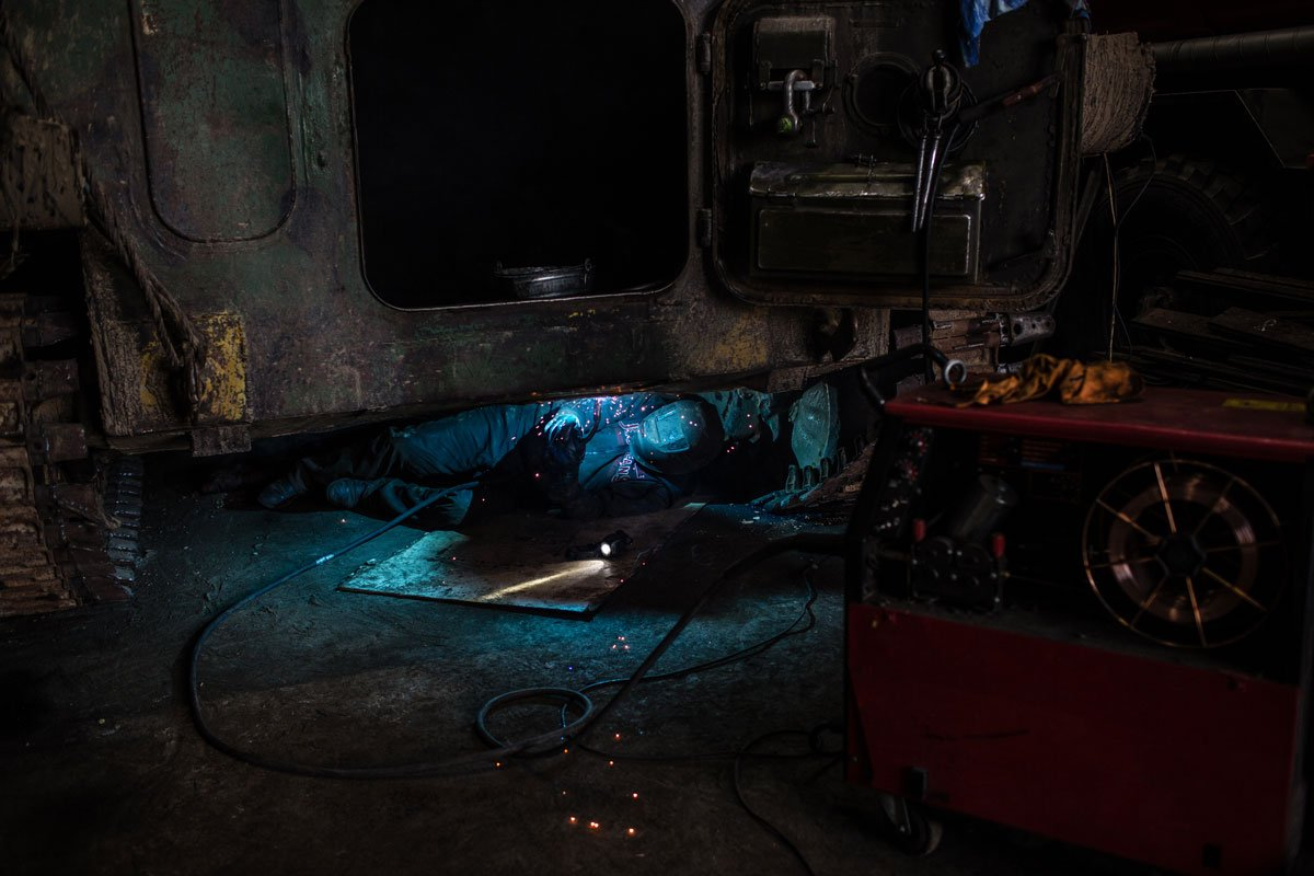 Workers at a garage for tracked vehicles. During frequent strong snowstorms and snowfalls, driving in Vorkuta is very difficult. Inhabitants can move only by using vehicles with tracks, or tractors