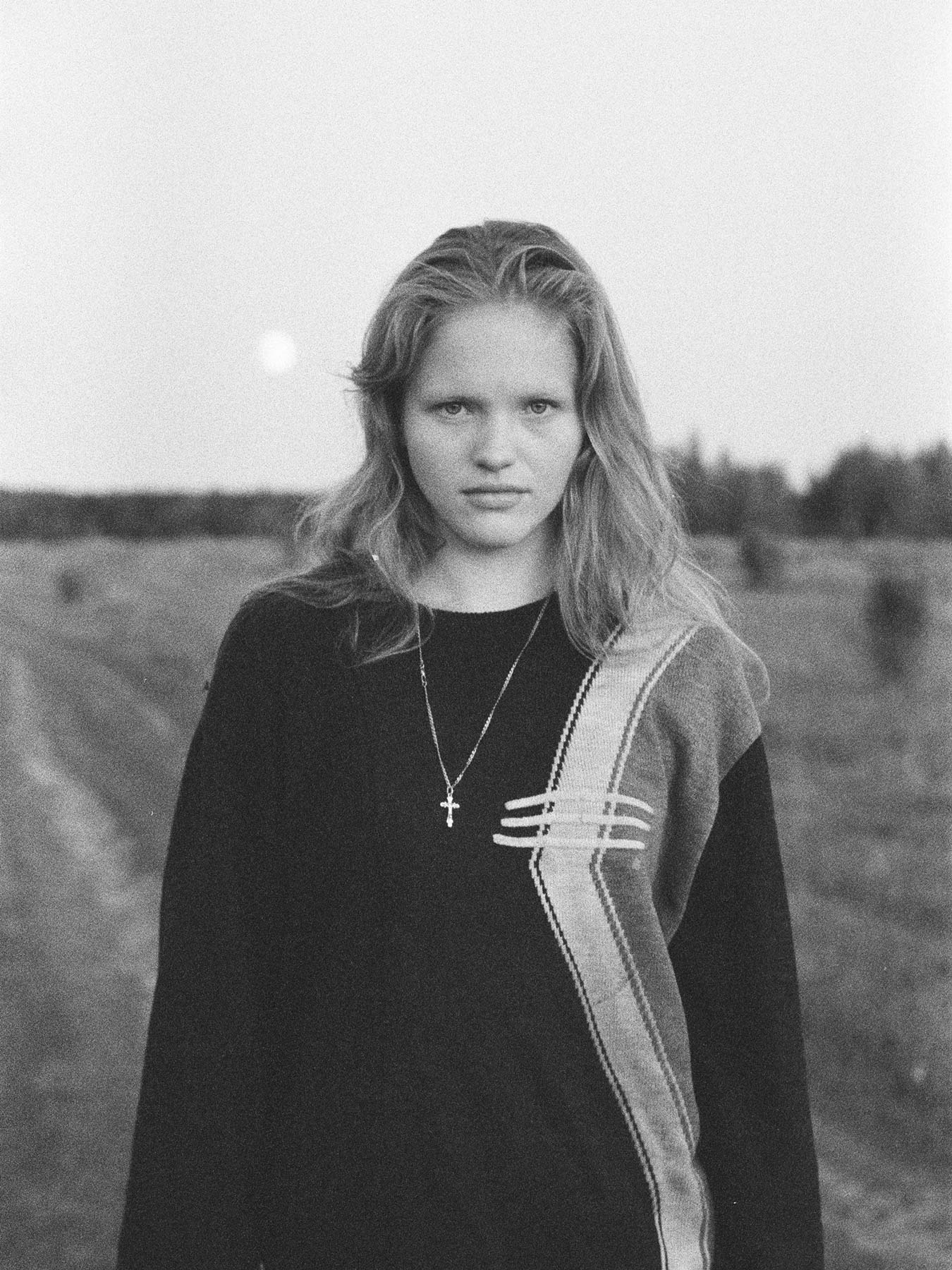 "<p>This portrait of Irina in Kargaleyka village is part of Masha Demianova's long-term project ""Hometown"", an exploration of Russian beauty, femininity, belonging, and landscape. The photographer travelled to different remote locations in Russia to document her friends' and models' hometowns.</p>"