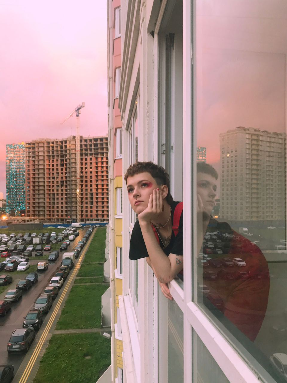 "<p><b></b></p>  <p><span>This portrait of a non-binary queer activist Katya Voziyanova was taken by their friend Sam on the morning after their 21st birthday. The photo was taken in St Petersburg, and has a spirit of gentle candid romanticism, taken amid towering housing developments still under construction. ""I think this picture was taken after we had champagne and cigarettes for breakfast. It was the morning after my birthday and it was our 19th hour of nonstop drinking, because that's what you do when you turn 21. It was a good day in the midst of the end of the world,"" Voziyanova remembers. </span></p>"
