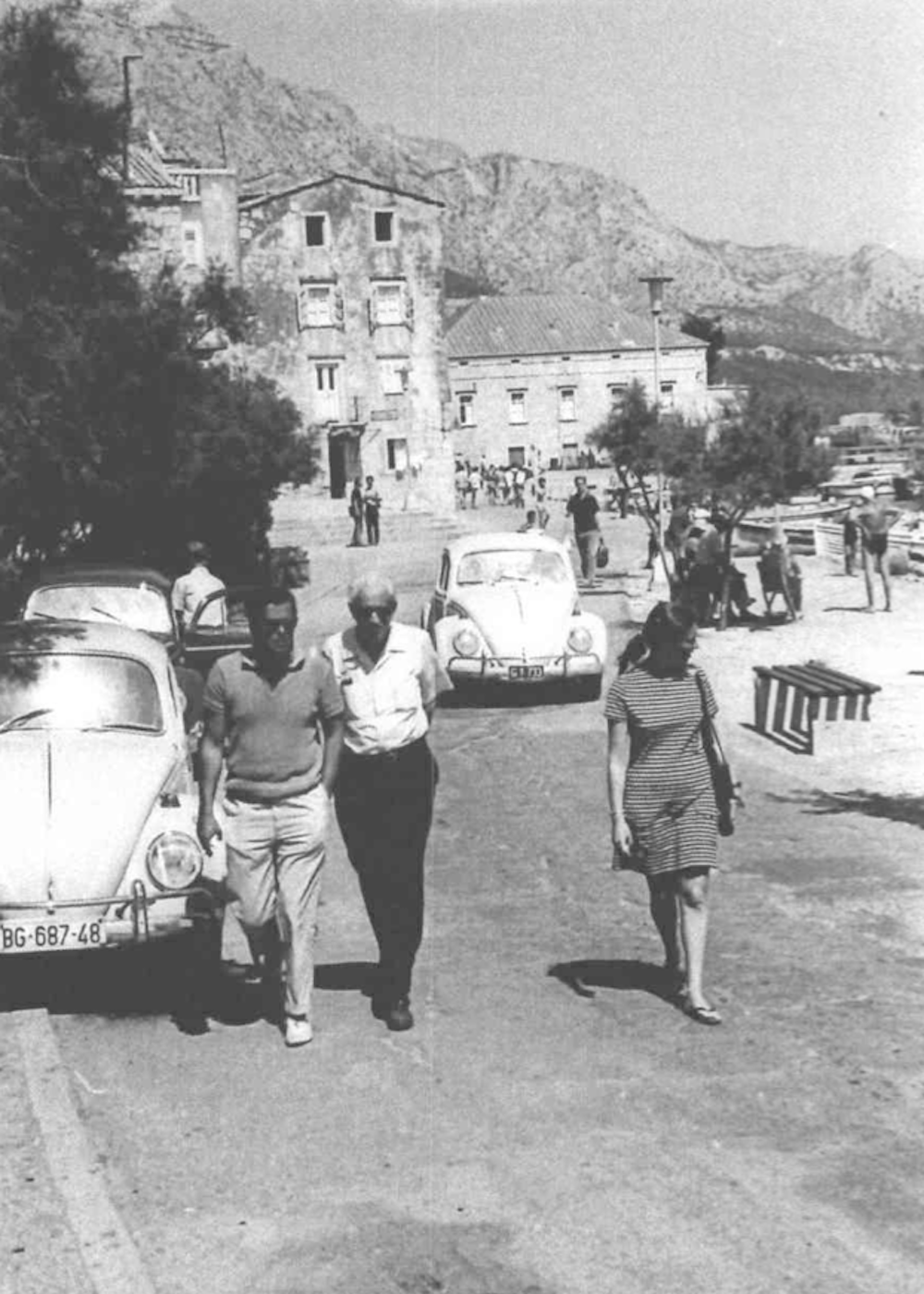 Heinz Lubasz and Herbert Marcuse walk past Korčula's House of Culture. Image courtesy of the Praxis Digital Archive