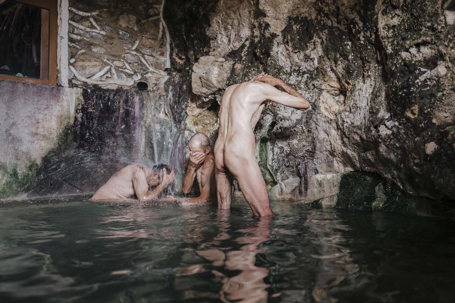 Men bathing in the Bibi Fatima hot springs, deep in the Wakhan Valley