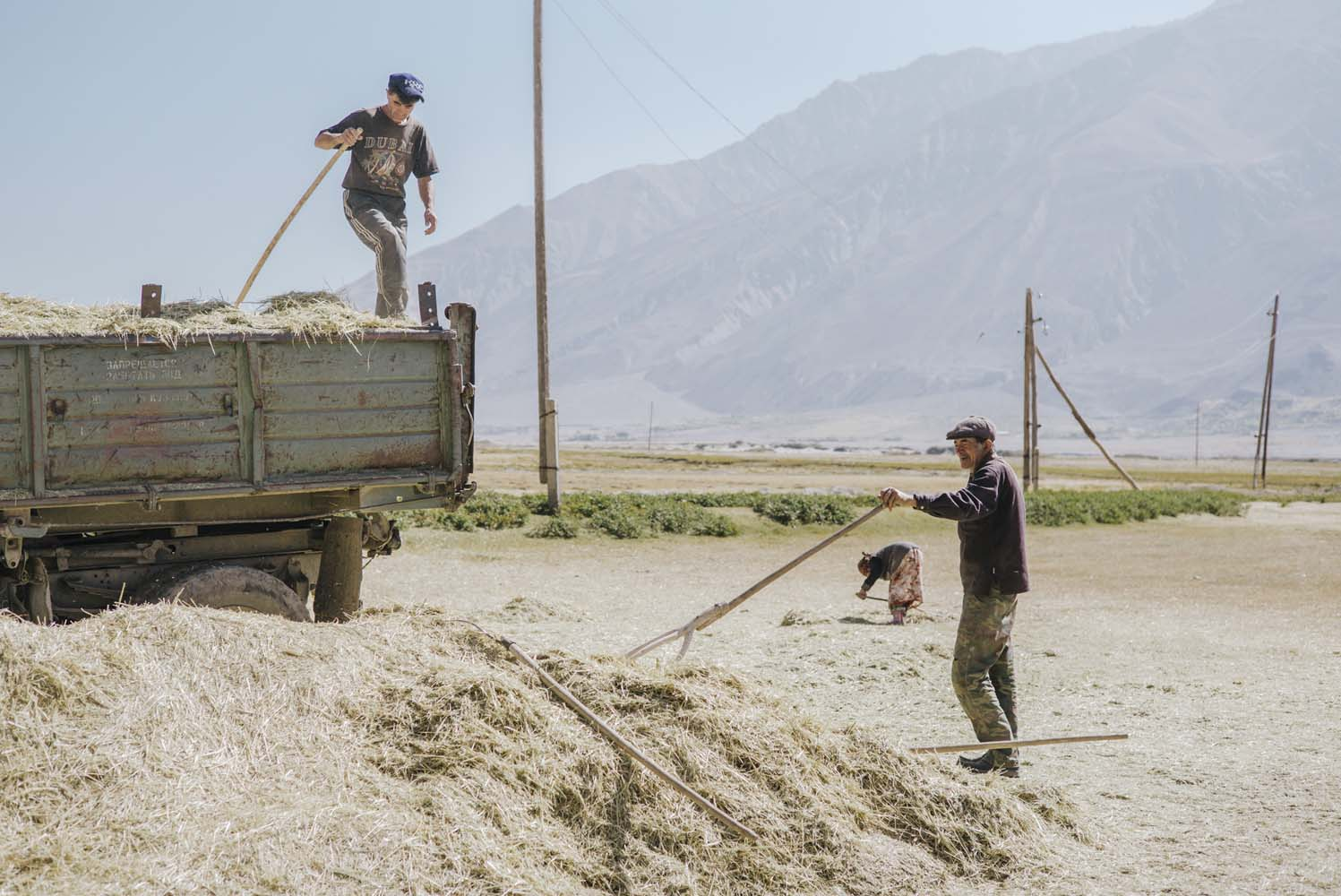 Farmers working with rudimentary techniques in the Pamir Mountains