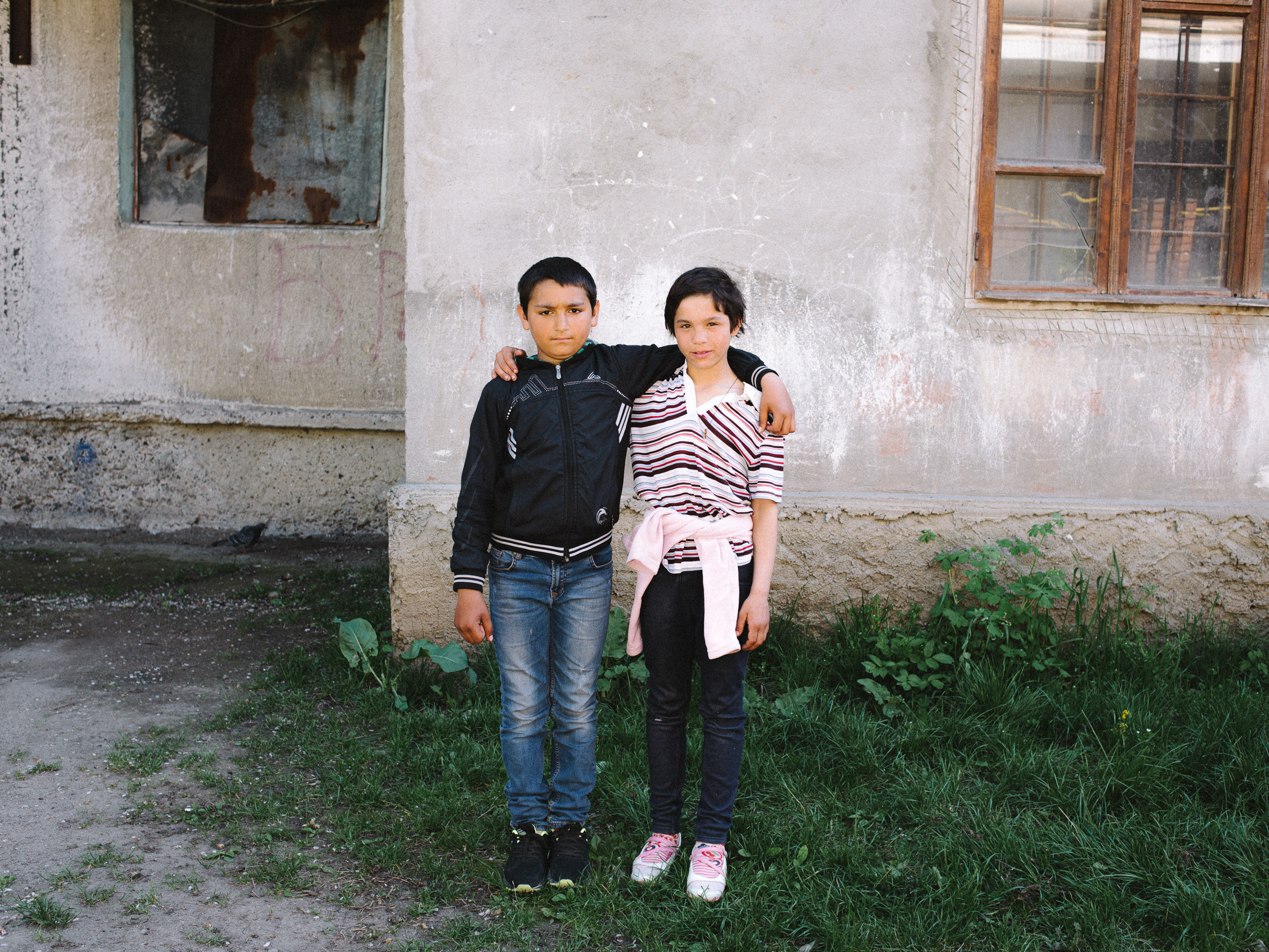 Matvej, 11, with his cousin, in front of their home, 'the Titanic'