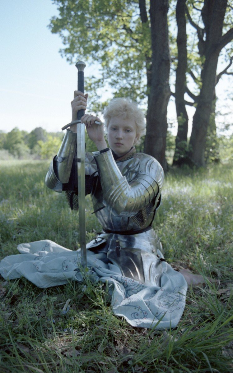 """<p>Emerging photographer Ivan Vorobyov took this portrait at the age of 18 in 2019, in the village where he grew up. He describes this series as, """"a slightly awkward but sincere ode to romanticism and happiness"""". """"Sonya, who is in this image, is also my teenage sweetheart. The armour was very heavy and she needed to rest in between shots. That's when I took this photo, when she was resting before completing her next heroic deed"""". </p>"""
