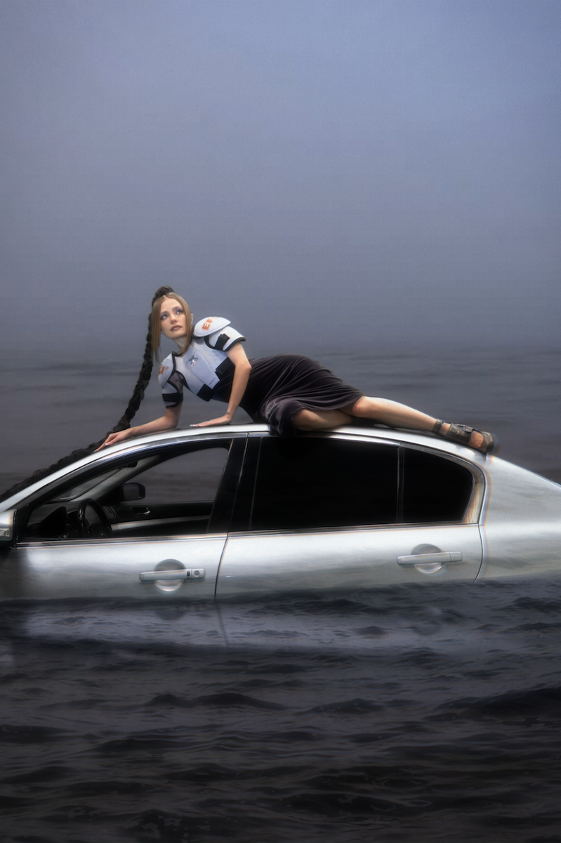 """<p><span>This portrait of Avdotja Alexandrova, the founder of globally-acclaimed modelling agency Lumpen, was taken by Nastya Vladimirskaya in 2020 as part of a shoot for vintage seller Arineari Archive. Using a green screen and one of the vehicles from the recently-launched Lumpen Cars (the agency's sister project offering vehicles for film and photo shoots), the photographer has created a cold yet enchanting visual narrative: a dreamy dystopia injected with new-gen glamour. """"I invent the worlds my characters end up in during the shoots — no one else is ever completely aware of them beforehand,"""" she says. <br>  </span></p>"""