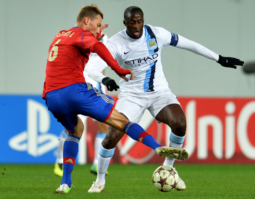 Alexei Berezutsky of PFC CSKA Moscow in action against Yaya Touré of Manchester City FC at the Arena Khimki Stadium in Russia. Photograph: Epsilon/Getty