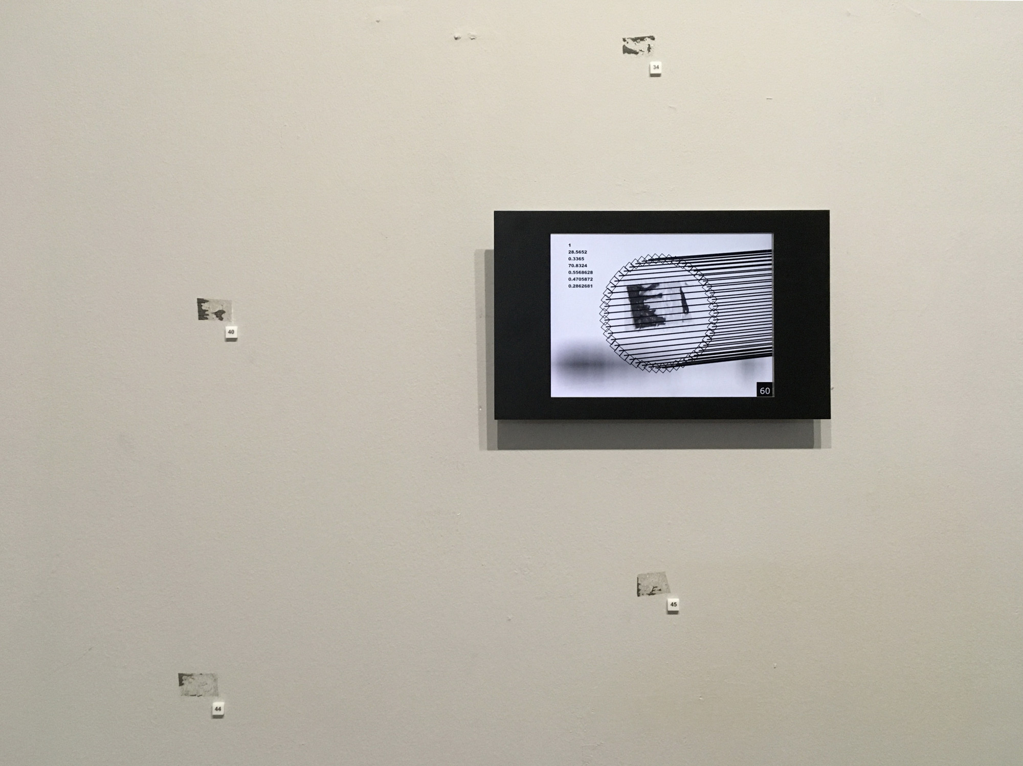 Fragment of the Tape Marks installation, 2o19. Impulse exhibition, Kuryokhin Centre, St Petersburg. An algorithm gathers information from tape marks that remained from a previous exhibition