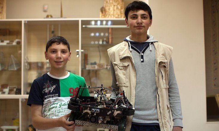 Rafael and Sahak Sahakyan with their firefighter robot. (Image: Suren Stepanyan)