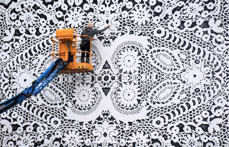 Meet the Polish painter mixing lace doilies and kick-ass street art