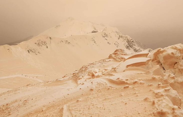 Orange snow transforms snowscapes into alien worlds across the New East