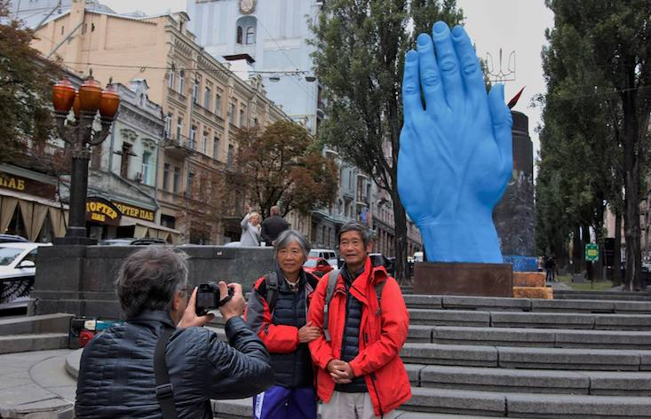 Kiev has replaced the city's Lenin statue with a giant blue hand