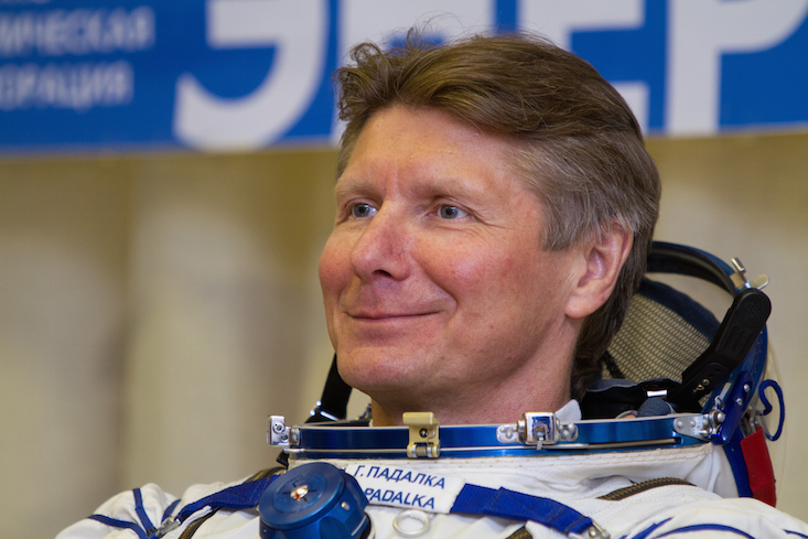 Record-breaking cosmonaut returns to Earth