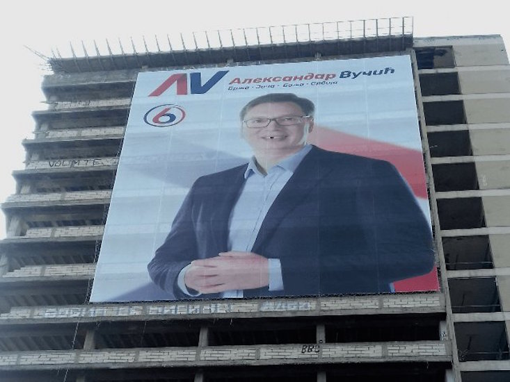 Poster of Serbian PM gets very own security guards